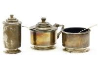 Lot 95 - An Art Deco silver three piece cruet by Edward Barnard & Sons