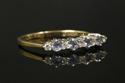 Lot 5 - A 9ct gold tanzanite and diamond nine stone ring