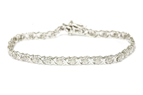 Lot 35-A 9ct white gold illusion set  brilliant cut diamond line bracelet