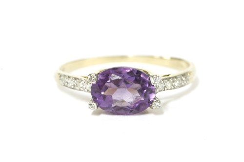 Lot 37-A 9ct gold single stone oval cut amethyst and diamond ring