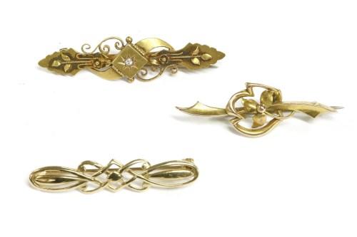 Lot 21-A Victorian gold single diamond bar brooch