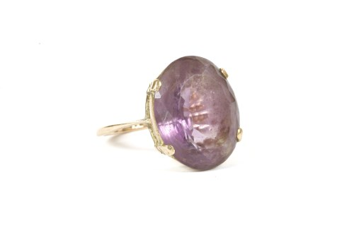 Lot 12-A gold single stone oval cut amethyst ring