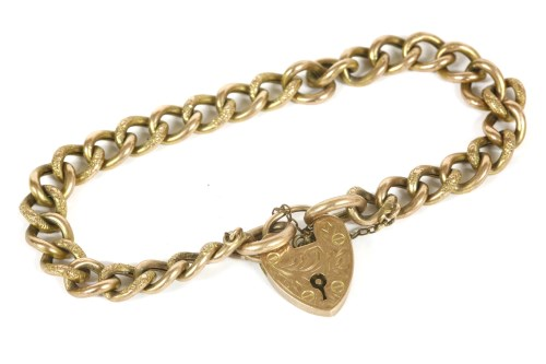 Lot 5-A gold hollow curb link bracelet with padlock