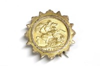 Lot 3-An Edward VII sovereign in a gold brooch mount