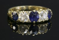 Lot 91 - A late Victorian sapphire and diamond carved head ring