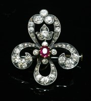 Lot 49-A Continental ruby and diamond fleur-de-lys brooch