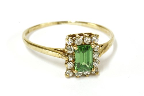 Lot 23-A 9ct gold emerald cut green tourmaline and cubic zirconia rectangular cluster ring