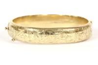 Lot 24-A 9ct gold hinge bangle