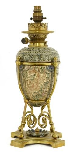 Lot 40-A Doulton Lambeth stoneware oil lamp