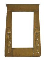 Lot 8-An Art Nouveau copper framed mirror