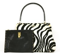 Lot 1037-An Escada zebra patterned tote shopper handbag