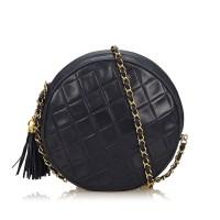 Lot 1048-A Chanel matelassé tassel lambskin leather handbag