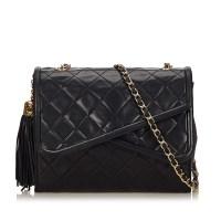 Lot 1053 - A Chanel matelassé tassel double flap shoulder bag