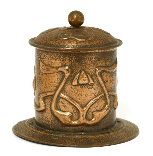 Lot 58-An Arts and Crafts copper tobacco pot and cover