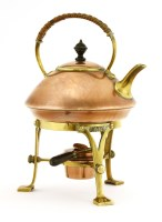 Lot 65 - An Arts and Crafts copper and brass kettle on stand