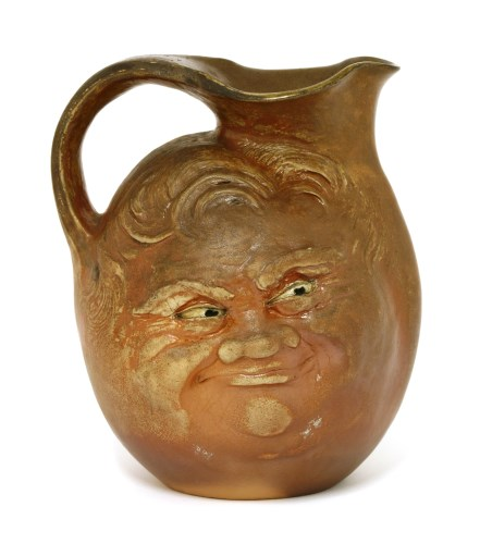 Lot 51-A Martin Brothers' brown-glazed mask jug