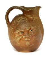 Lot 51 - A Martin Brothers' brown-glazed mask jug