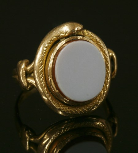 Lot 9-A gold sardonyx ouroboros ring