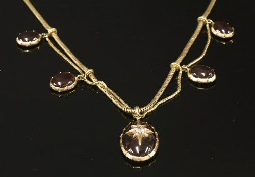 Lot 22-A Victorian gold garnet and diamond swag necklace