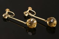 Lot 18-A pair of gold smokey quartz coloured paste stone drop earrings
