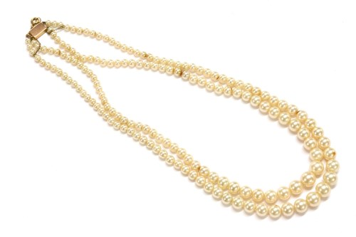 Lot 3-A two row graduated simulated pearl necklace