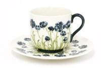 Lot 93-A Moorcroft Macintyre pottery 'Poppy' cup and saucer