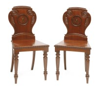 Lot 38 - A pair of George IV mahogany hall chairs