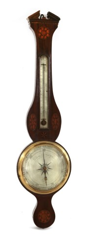 Lot 23-An inlaid mahogany wheel barometer