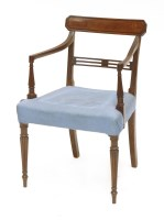 Lot 31 - A George III mahogany bar back elbow chair