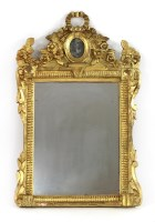 Lot 32 - A carved giltwood wall mirror