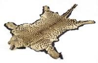 Lot 33 - A leopard-skin rug