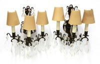 Lot 18-A pair of three-branch wall lights