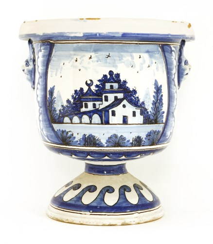 Lot 16-A tin-glazed blue and white pottery urn
