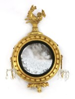 Lot 75 - A George III giltwood convex wall mirror