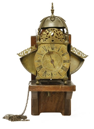 417 - A brass winged lantern clock