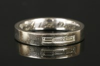 Lot 15-An 18ct white gold three stone baguette cut diamond wedding ring