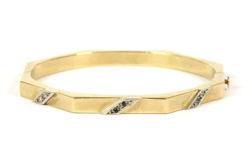 Lot 32-A hollow gold octagonal hinge bangle