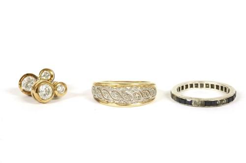 Lot 22-A 9ct gold diamond set band ring