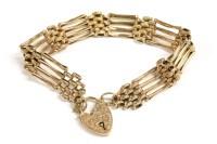 Lot 79 - A gold four row bar link gate bracelet
