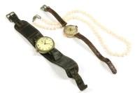 Lot 90-A 9ct gold Afra mechanical strap watch