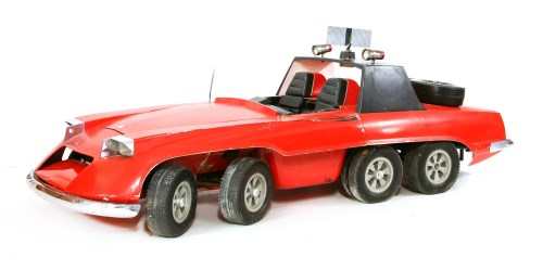Lot 570-An original film prop for the 'The Investigator' a six-wheeled car