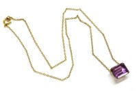 Lot 46-A gold emerald cut amethyst pendant