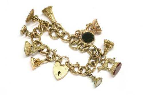 Lot 59-A 9ct gold curb link charm bracelet with padlock