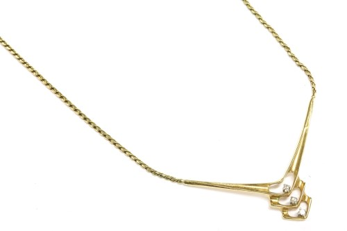Lot 16-A 9ct gold necklace with diamond set 'V' shaped centrepiece