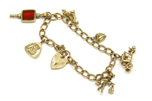 Lot 49-A 9ct gold curb link bracelet with padlock