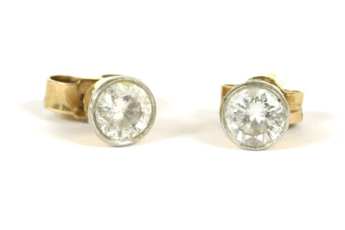 Lot 6-A pair of 18ct gold single stone diamond stud earrings