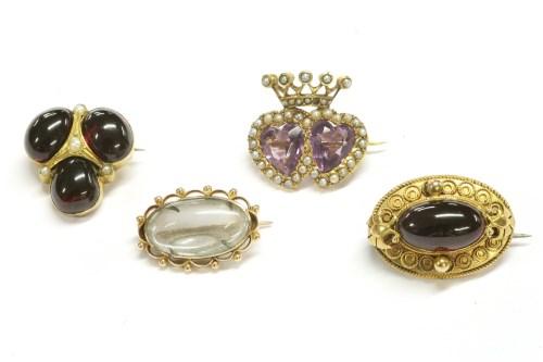 Lot 28-A gold amethyst and split pearl twin heart brooch