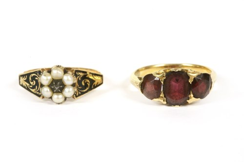 Lot 31-A gold three stone garnet ring