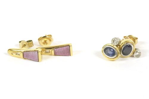 Lot 19-A pair of 18ct gold diamond and sapphire stud earrings