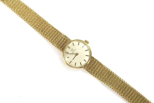 Lot 64-A ladies 9ct gold Omega mechanical bracelet watch